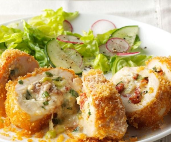 Fontina Rolled Chicken with fresh veggie on a plate