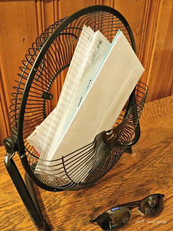 Repurposed fan with Envelopes in it