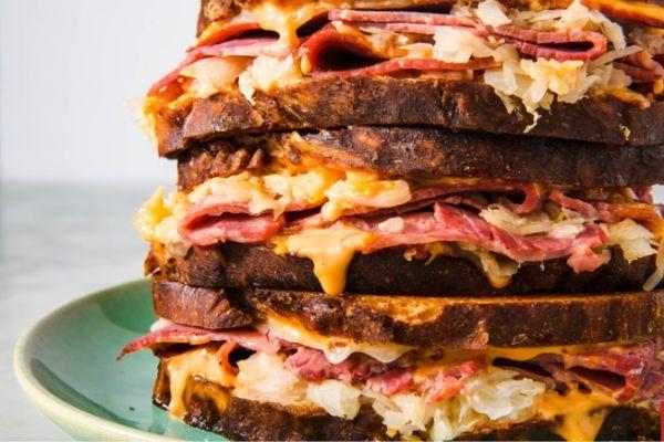 Three Reuben Sandwiches on a Plate