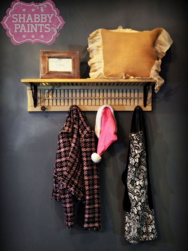 Repurposed Shutter with clothes hangin and pillow on it