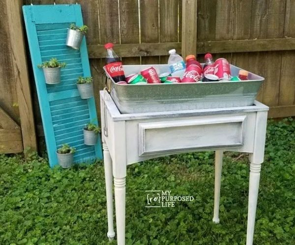 Drink Station Sewing Machine Cabinet with Lot if Drink Can on it