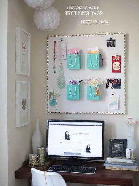 Vision board sticked to the wall with organized shopping bag on top of it