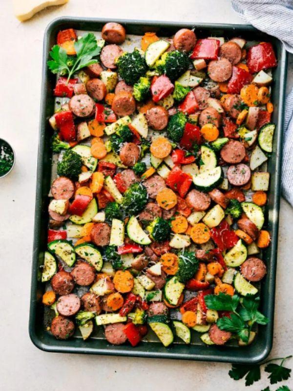 Black Sheet Pan filled with Italian Sausage and Veggies