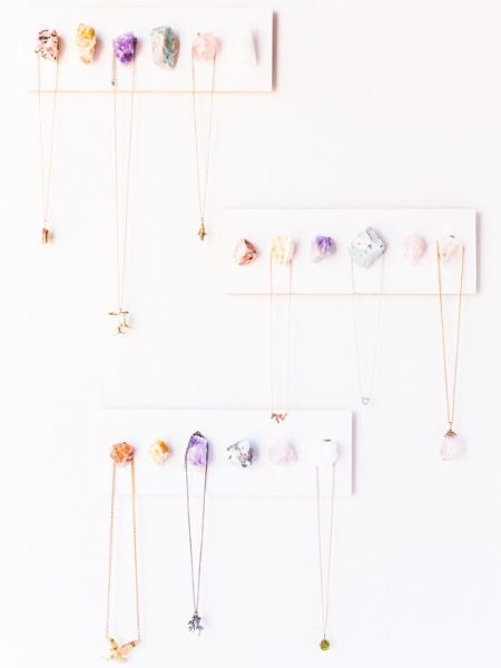Crystal sticked to the wall as a necklace display