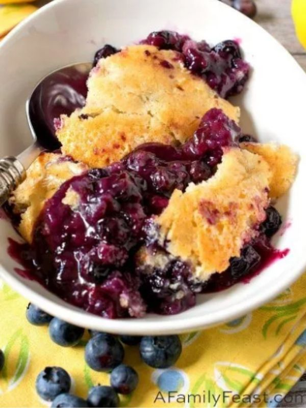 A Bowl of Blueberry Pudding Cake with A Spoon