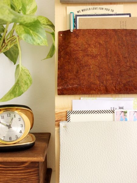 Leather organizer on the desk with desk table and plant beside it