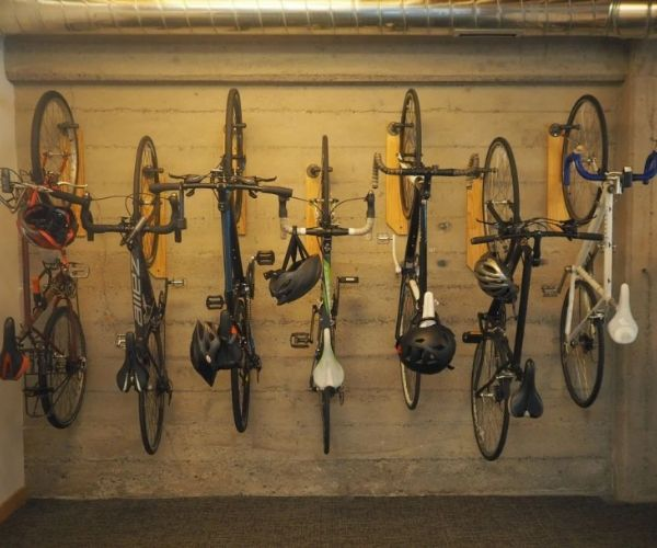 7 bikes hanging on a garage wall