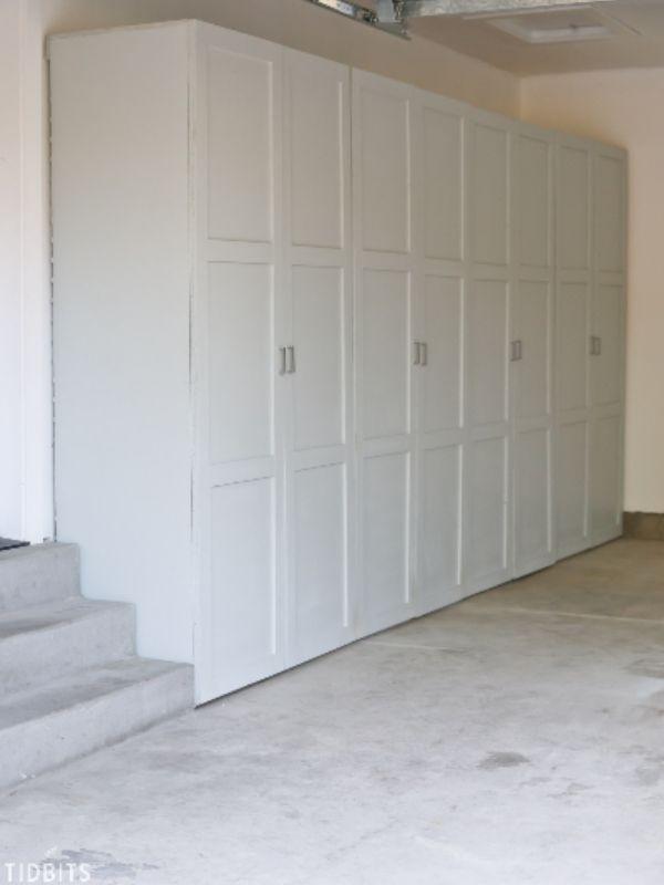 4 white storage cabinets in a garage