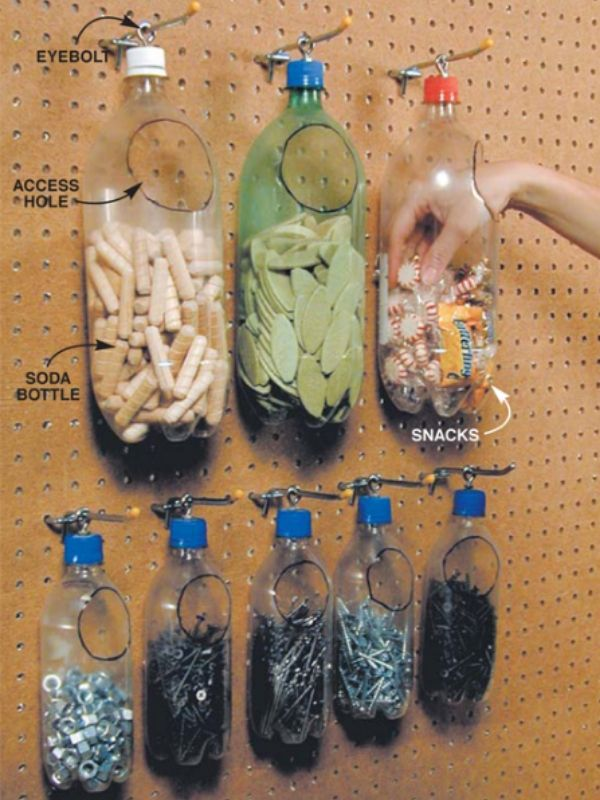 8 soda bottles hanging on hooks that installed in a pegboard